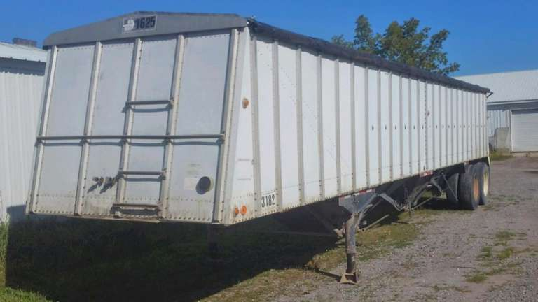 1981 Merritt Hopper Bottom Trailer, Spring Ride, Aluminum with Steel Hopper, 24.5 Tires and Brakes at 25-30%, Good Shur-Lok Tarp.  Cracks, Welded and Patched, Ready to Haul, All New Wiring Front to Back, Clean and Clear Title