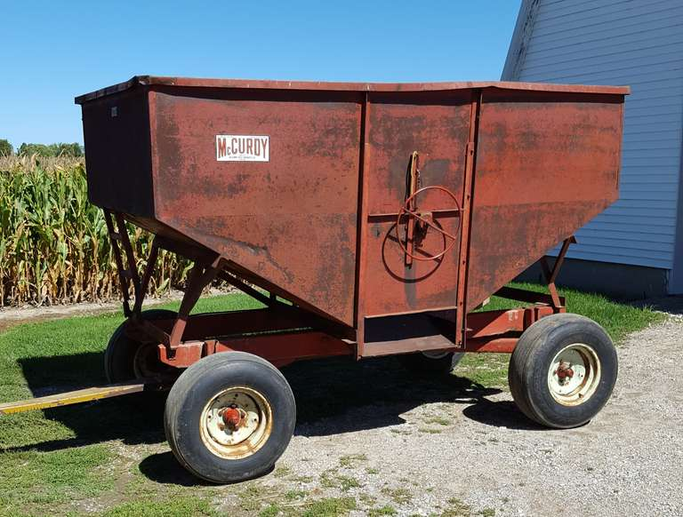 McCurdy 140 Bushel Gravity Wagon on Kewanee Running Gear, Has One Very Small Hole and Could Use Tires, Was Used on Stationary Feed Wagon