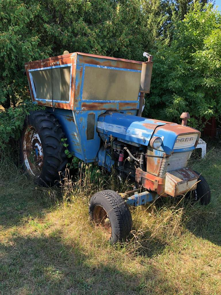 Old Ford 5000 Tractor with Shop Built Cab, 3pt, PTO, One Hydraulic Outlet, Rear Fenders are Included, Comes with Repair Manual, Dated, 1966, Rear Goodyear 15.5-38 Tires Look Good, Has been Sitting Possibly 10 Years and Radiator is Empty and Looks Like Water in Oil, As Is, No loader tractor available to load this item