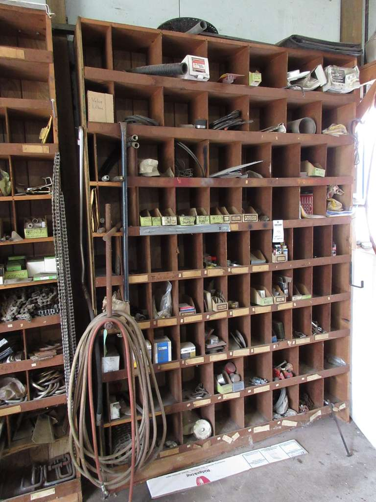 Entire Contents of Wall Unit, Includes: Chain Pieces, Turn Buckles, Handles, Grease Caps, Catelated Nuts, Stud Bolts, Hydraulic Hoses, and More, Wall Unit Sells with Contents if Wanted, Buyers Responsibility to Remove and Load