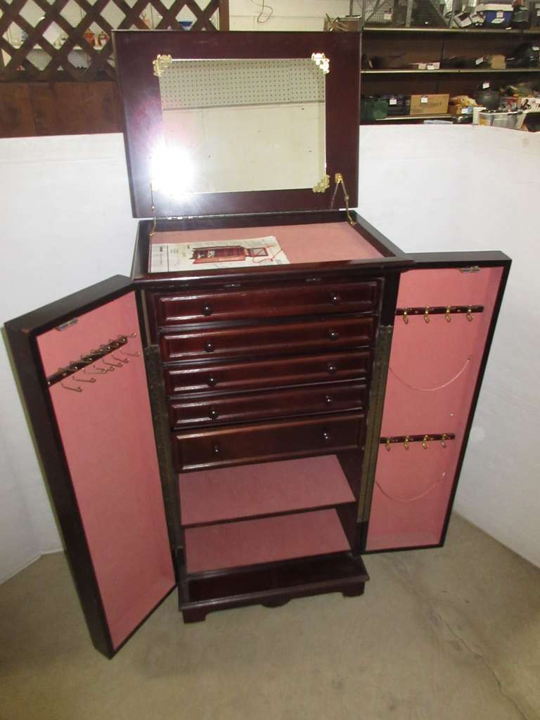 Older Jewelry Armoire by Powell No. 388, Flip Top Mirror, Sides Swing Out for Loads of Storage, Five Plush Lined Drawers, Two Lined Shelves to Store Purses, Sweaters, and Accessories