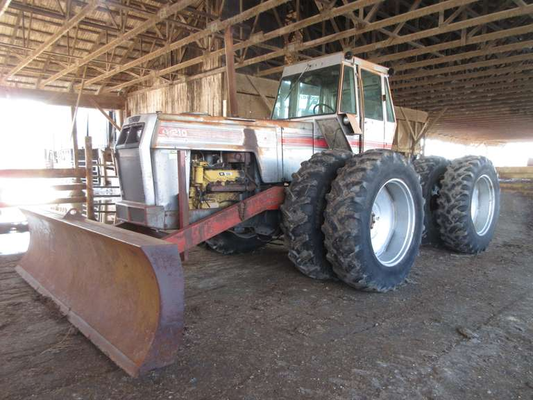 White 4-210 4x4 Tractor with 8' Shop Built Blade (Blade built by Ellis Gardner), (Approximately 10,000 Hours), Mod No. 421-82132, CAT 3208 Remanufactured Engine (Remanufacture approximately 1992), 18.4-38 Duals, 3-Point Hitch, PTO, (3)-Remote Hydraulic Outlets.  Note:  A video of this item can be viewed.  Click on the Thumbnail photo, locate the picture with the play tab, click play to watch video.