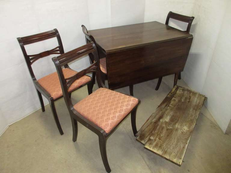 Very Old Drop Leaf Table with (3) Extra Leaves and (4) Chairs
