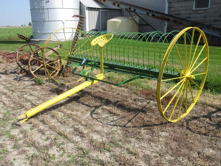 "Antique Steel Dump Rake with 54"" Steel Wheels, 124"" Wide, Painted John Deere Green and Yellow, Good Condition"
