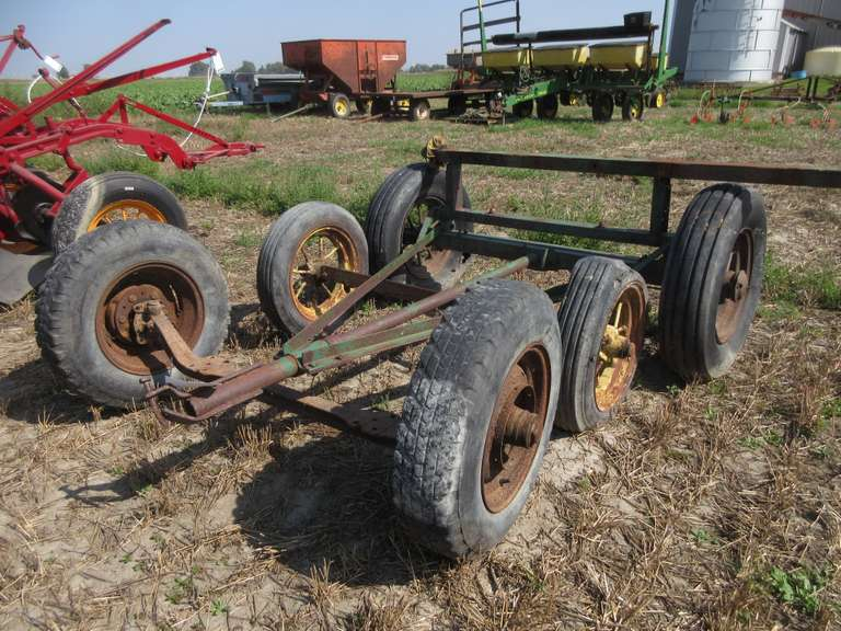 "(4) Old Axles with (6) Wheels, Four are 16"" Steel Spoke Wheels"
