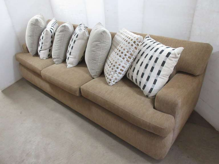 Cream Three-Seat Sofa with Decorative Pillows