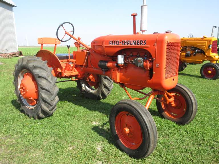 Allis-Chalmers 'C' Tractor, Wide Front, Worn 10-24 Tires but Holding Air, Like New Front Tires, Excellent Paint, Show Ready, P.T.O. and Belt Pulley, Runs Great, Has a Leak on Pipe on Top of Radiator that Needs to be Repaired