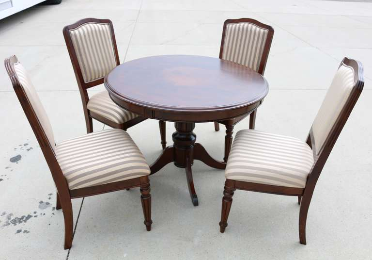Dining Room Table With Pinwheel Design and (4) Fabric Chairs