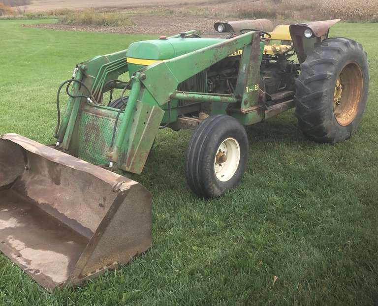 1979 John Deere 2440 Diesel Tractor with Model 146 Loader, 63 hp, 3-Point Hitch, Dual Remote SCV's, Power Reverse, Block Heater, 4-Speed with Hi-Lo Range, Tires are Approx. 40%, New Batteries, Sells with New Re-Seal Kit for Hydraulic Pump and Service Manuals, Engine Will Need Rebuilding (Engine Coolant is Leaking into the Motor Oil)