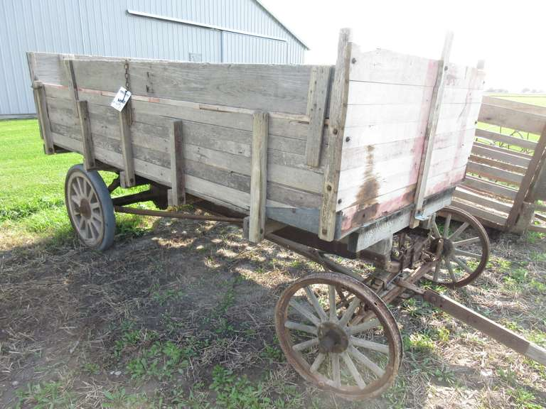"Antique Wagon with Wood Spoke Wheels, box is 64"" x 10' Long, Floor has Patches and Small Hole, Front Treads Missing (One in Wagon)"