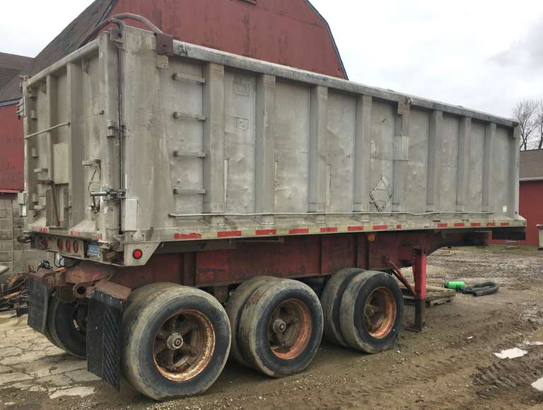 26' Tri-Axle Trailer, Dual End Gate with Small Grain Door, Good Floor and Sides, Needs Two Tires Changed (Comes with the Two Tires), Has One Lift Axle, Good Landing Gear, Two-New Rear Brake Chambers and Brakes Shoes are Recently New, Clean and Clear Title