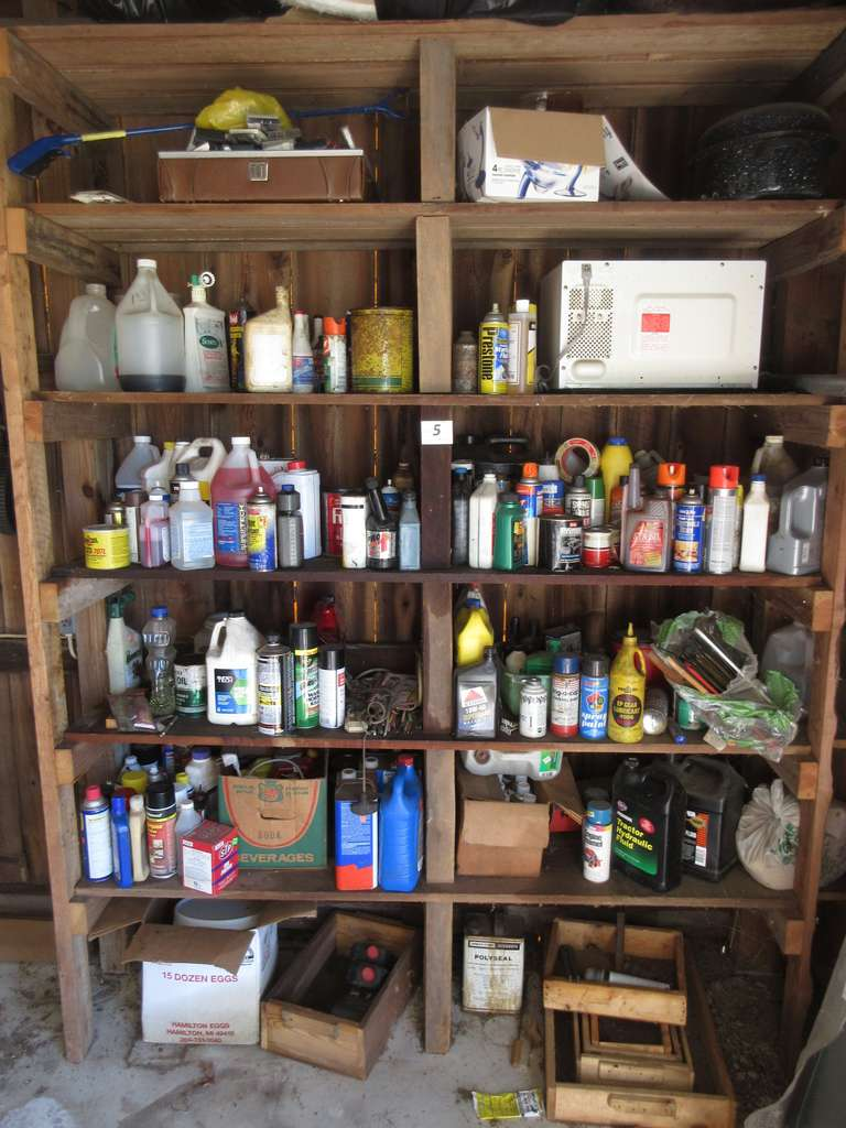 Contents of Large Shelf.  Includes: Oil, Paint, Lubricant, Etc.  Note:  Shelf Not Included.