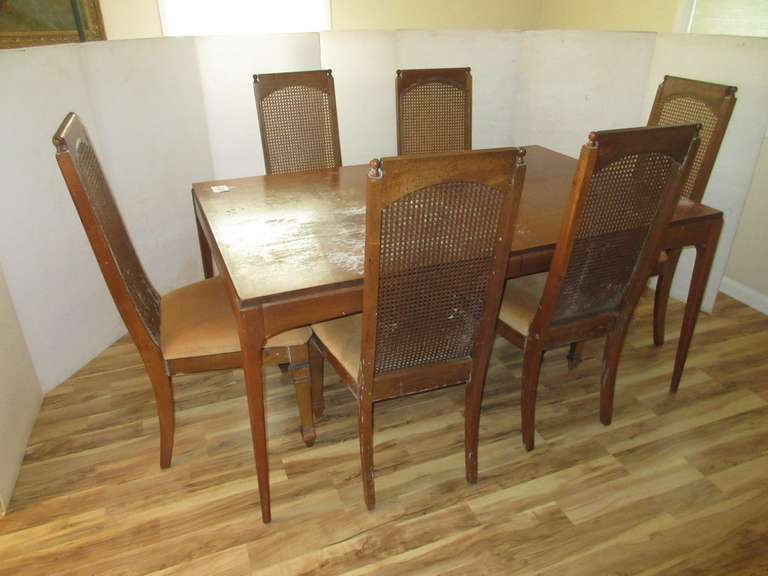 "1960s Lane Walnut Dining Table with (2)-Leaves.  Top needs cleaning from table cover, but should clean up nice.  Comes with (6)-Cane Back Chairs that also need cleaning.  Top is 40"" x 62"" Plus (2)-18"" Leaves"