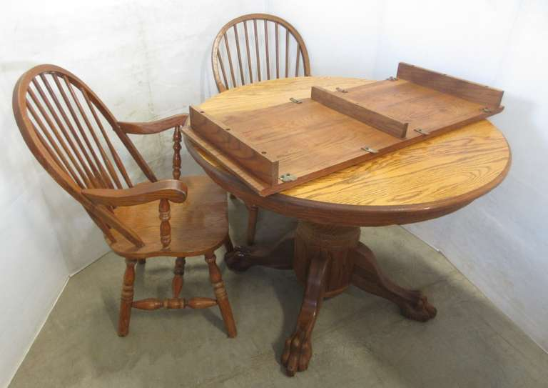 "Solid Oak Pedestal Table with Claw Feet and 18"" Leaf, Also Includes (2) Captains Chairs"