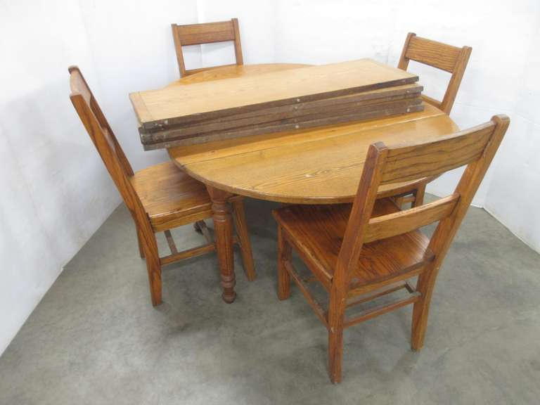 Oak Table with (4) Chairs, and (5) Leaves