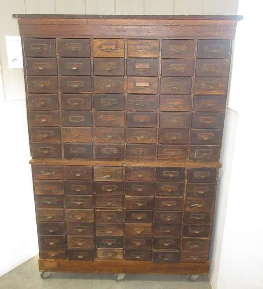 Antique 84-Drawer Oak Hardware Cabinet with Casters