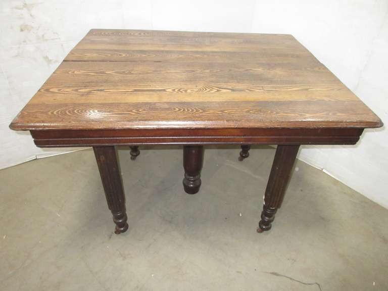 Older Oak Five-Leg Table with Marker Name on Top
