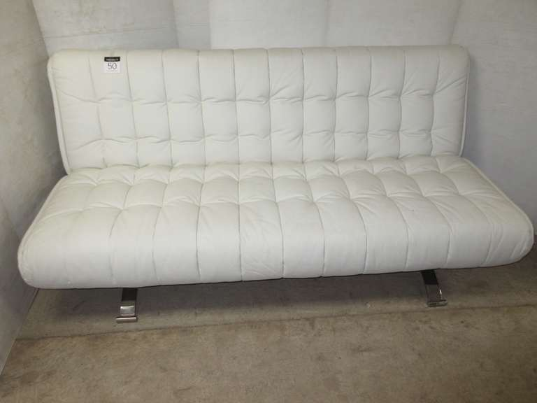 White Tufted Leather Futon Accent Couch with a Chrome Base, Can be Used as a Couch or Futon Bed, Well Made