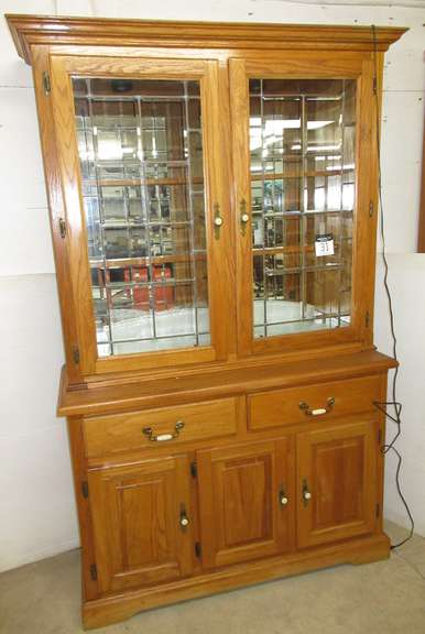Oak Two-Piece Lighted China Cabinet with Leaded Glass Doors, Two Glass Shelves, One Wood Shelf, Three Doors on Bottom with a Wood Shelf, Matches Lot No. 28