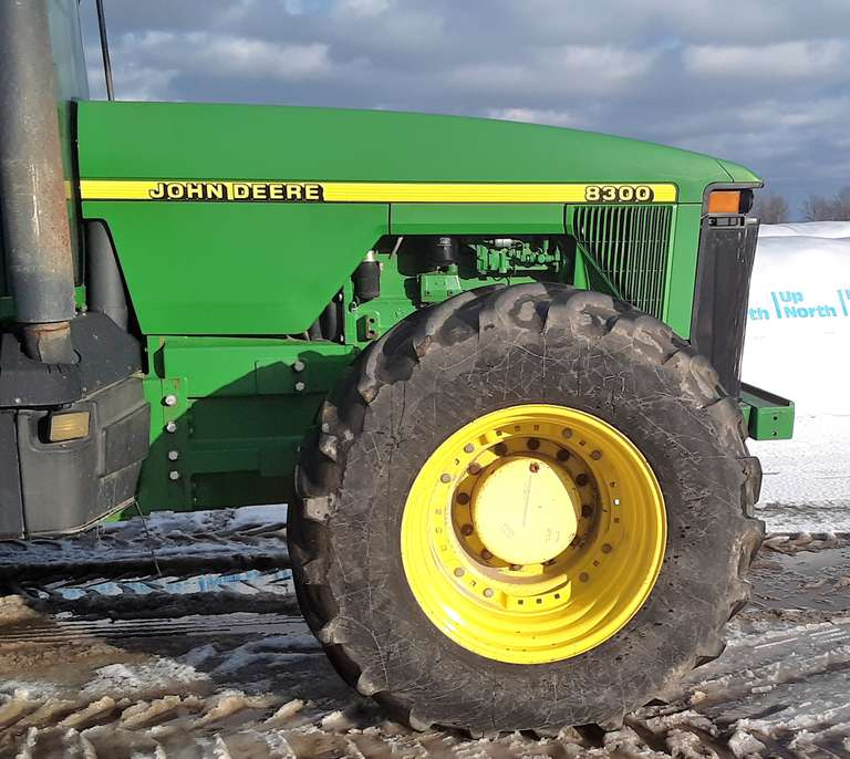 1997 John Deere 8300 MFWD Tractor, (9155 Hours), Serial No. RW8300P021242, 18.4-46 Duals, 540/65/R30 Fronts, (2)-225 KG Rear Wheel Weights, (2)-205 KG Rear Wheel Weights, Front Weight Bracket, 5-Hydraulic Outlets, Large 1000 PTO, Quick Hitch, 6-LED Lights, Clevis Hitch, Buddy Seat, New Muffler