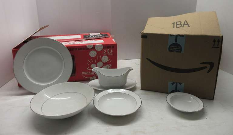 (8) Pieces of Crown China, Includes: Plates, Large Dessert Plates, Small Dessert Plates, Bowls, Saucers, Small Bowls, Cups, Cream and Sugar Set, Gravy Boat, Serving Tray, and Bowls