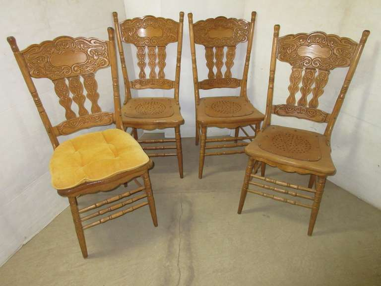 Set of (4) Oak Press Back Chairs
