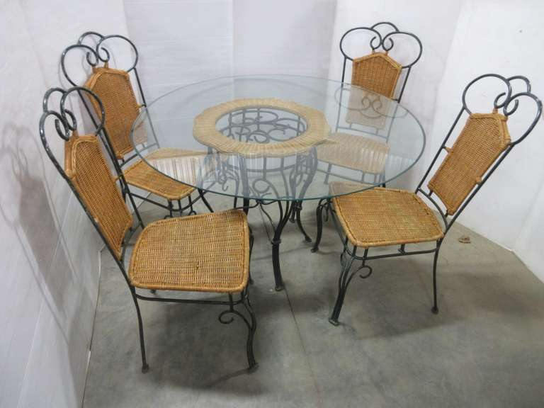 Glass Topped Wrought Iron Table and (4) Chairs