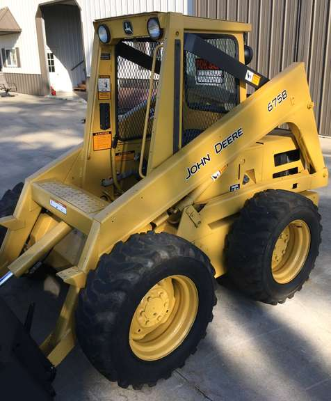 "John Deere 675B Skid Steer, Has Fresh Paint and Engine, Completely Rebuilt 44 hp Diesel, Including New Short Block and New Valves, Head Ground, Rebuilt Injection Pump and Injectors, New Gaskets and Block Heater, New Seat, Runs Like New, Mechanically Sound, Very Tight Machine, Everything Works Like it Should, All Fluids and Filters Changed, Greased and Ready to Go, Includes 72"" Bucket, (Bale Spear also Available for Additional Cost to Buyer)"