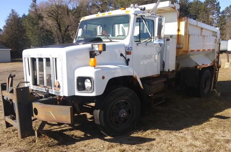 2000 International Harvester Company Navistar Model 2654 Dump Truck, (45,xxx Miles), Cummins Engine, Automatic Transmission, Has Good Rubber, Has Live Bottom, Was Previously Owned and Maintained by the City of Bay City, Runs Great, Rockers are Rusty Below the Doors, Clean and Clear Title