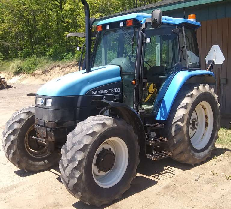 Ford New Holland TS 100 4x4 Diesel Tractor, (Approx. 5000 Hours), Tires are at 50%, Has Heat and Air Conditioning, Was Previously County Owned and Maintained, Runs and Operates Well