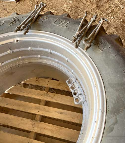 Pair of Goodyear 18.4-38 Duals with 9-Rim Clamps and 9-J Bolts, Rubber is in Good Condition, Came with a Used Tractor, Seller has No Use for Duals