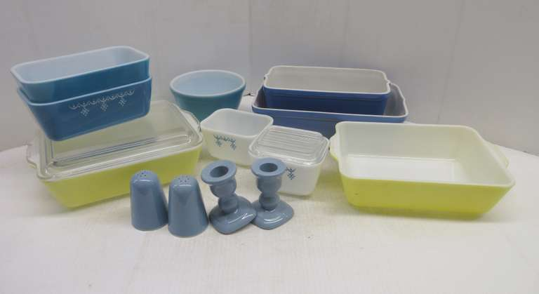 "(2) Yellow Pyrex Refrigerator Dishes, One Clear Lid has Chips, 7"" x 8 1/2"" x 2 1/2"", Color Faded; (2) Blue Pyrex Refrigerator Dishes, 6 3/4"" x 4 1/4"" x 2 3/4"", No Lids; (2) White Snowflake Pattern Dishes, One with Cover, 4 1/4"" x 3 1/2"" x 2 3/4""; Blue Hull Baking Dish, 10 1/2"" x 6 3/4"" x 3"", Has Surface Cracks and Chip on Top Edge; Blue Hull Baking Dish, 5 1/2"" x 8 3/4"" x 3 3/4""H, No Chips; Blue Pyrex Bowl, 5 1/2"", Chip on Edge; Princess House Salt and Pepper, Blue; Pair of Princess House Can..."