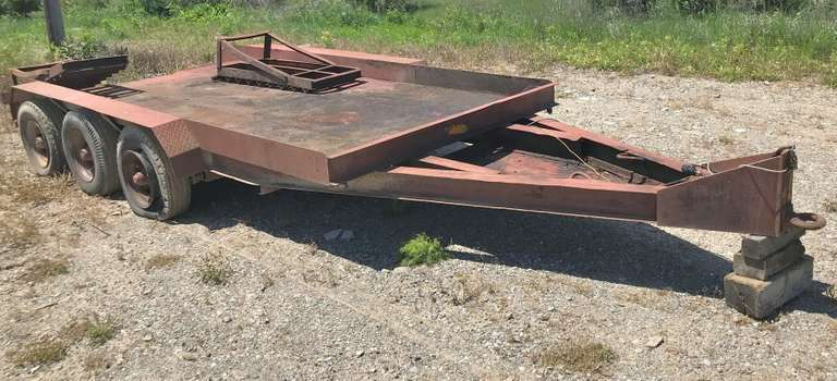 "Shop Built Tri-Axle Trailer with Steel Deck, 6'6"" Between Fenders, 15' (13' Flat Plus 2' Dovetail), Pintle Hitch, Needs Ramp Welded Back on, Needs Wiring Redone, Needs Tires (Not Towable with Current Tires), Seller Can Assist with Loading on Another Trailer with Skid Steer at Time of Purchase for Buyer, Trailer House Style Rims and Tires, Very Heavy Duty Trailer that Will be Nice with a Little Work, Comes with Bill of Sale"