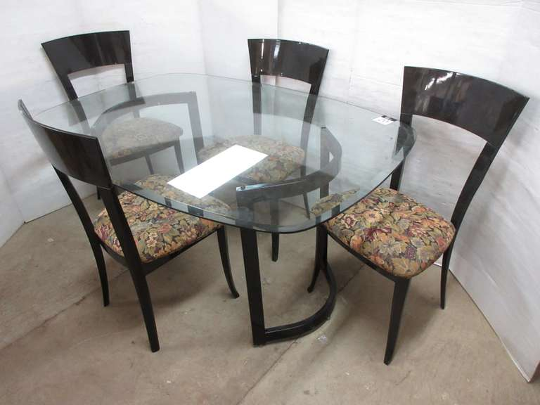 Glass Top Table and (4) Black Chairs