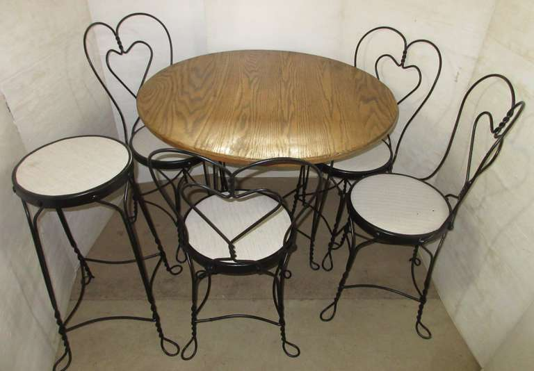 "Older Ice Cream Parlor Table Set, Heart Design, Includes: Oak Topped table, 36""Dia x 28""H; (4) Chairs; Stool, 28""H"