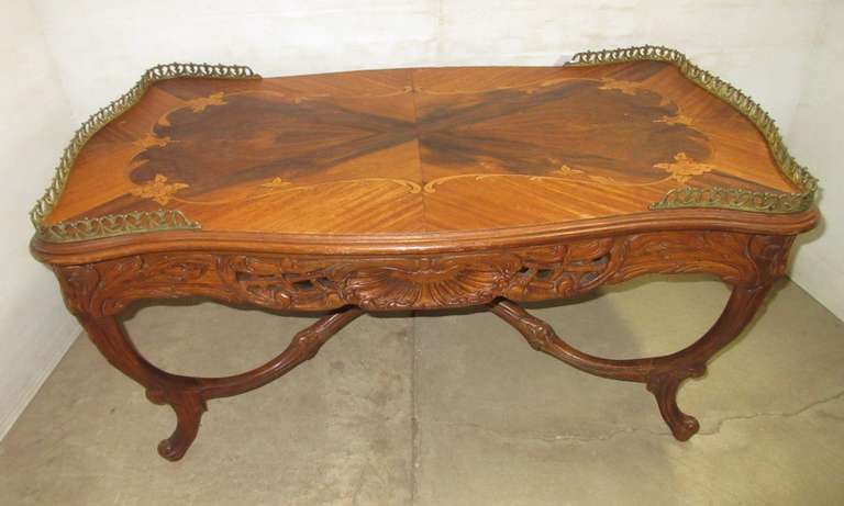 Over 100 Year Old Coffee Table, Made with Inlaid Wood, Various Colors, Brass Trim, Stenciled Flowers, Nice Carvings Around Sides and Legs