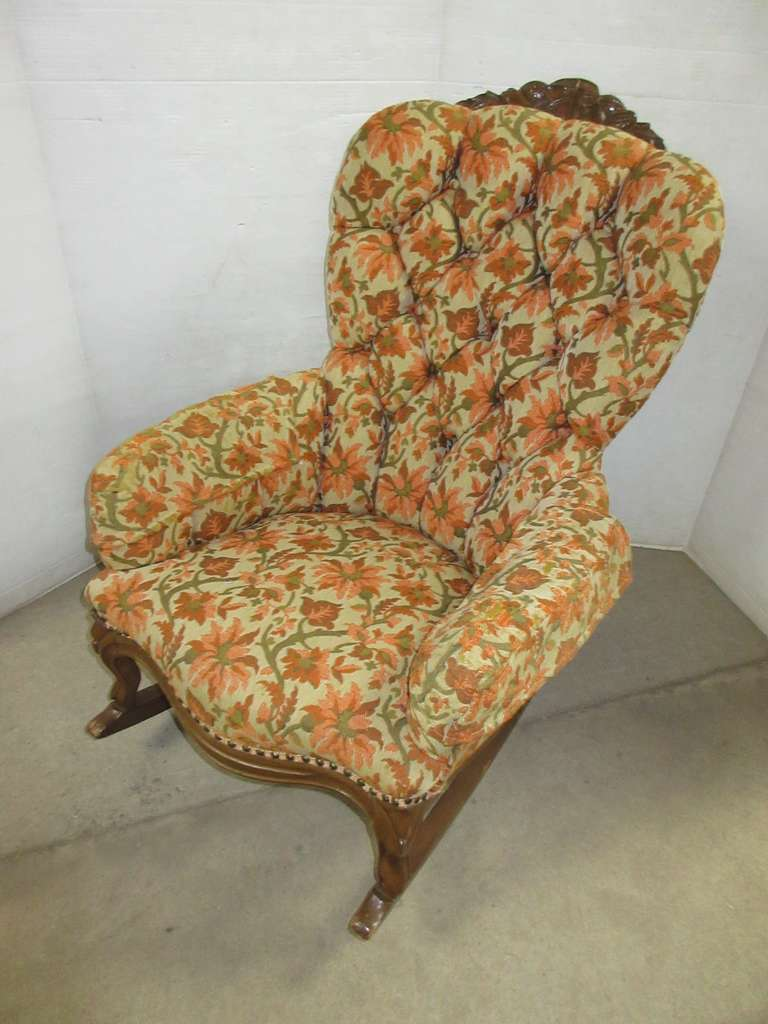 Antique Carved and Upholstered Rocking Chair