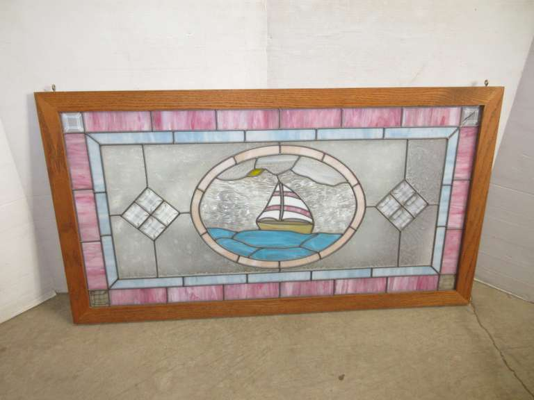 Stained Glass Window in Oak Frame with Sailboat Center