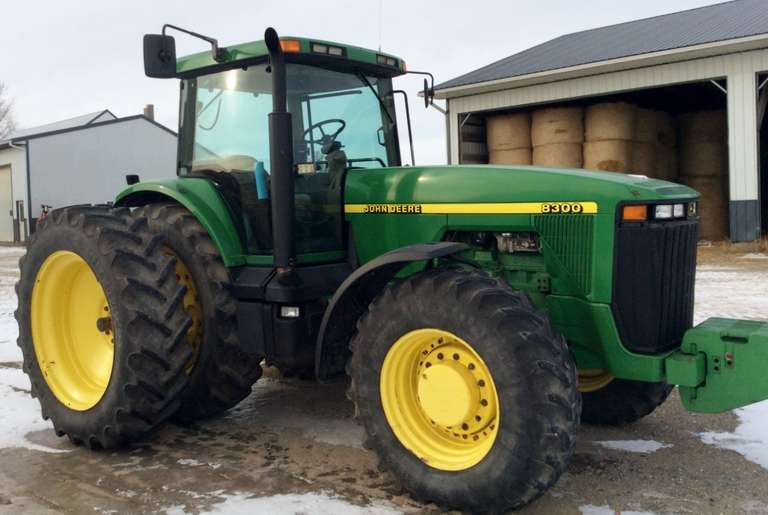 John Deere 8300 Tractor, (11,029.1 Hours), Has a New Radiator, Muffler, and Back Fenders, Performance Monitor Included, LED Lights, Hydraulic Trailer Brakes, Two-1,500 lb. Weights on the Back Tires, and 12-Front Weights, 3-Remotes Included, Winter Inspection, Runs Smoothly