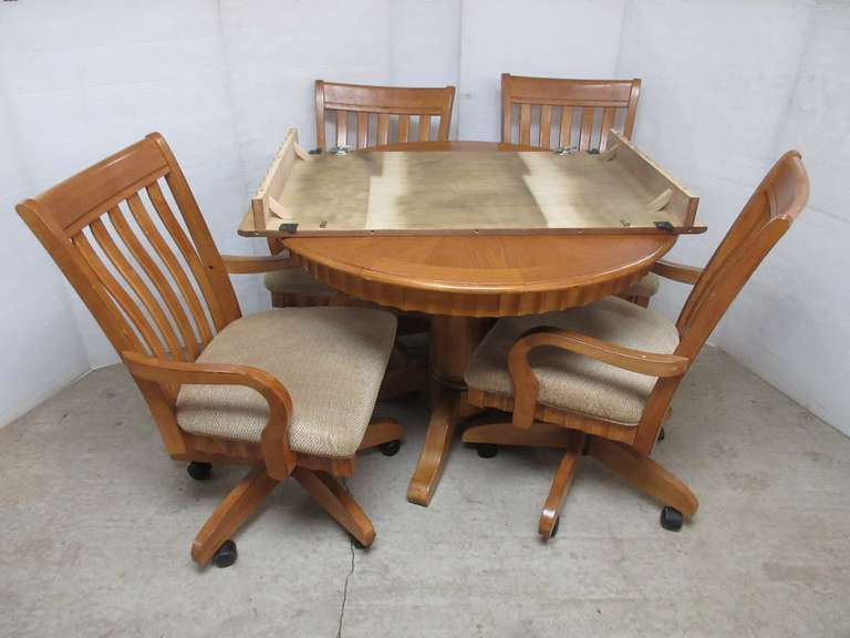Oak Table with Leaf and (4) Chairs with Rollers