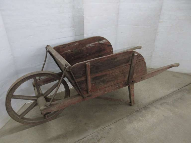 Circa 1900 Wheelbarrow with Wood Wheel, Removable Sides, Square Bolts