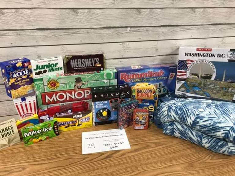 Stay at Home Package, Includes: Handmade Tie Blanket, 4D Time Puzzle, Rummikub, Friends Game, Monopoly  Panic Lab, Racoon Rumpus, Left Right Center Game, DOS Card Game, Assortment of Candy/Popcorn, $25 Gift Card to Barnes and Noble