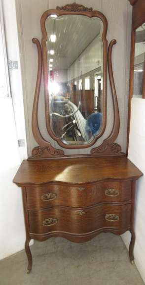 Antique Two-Drawer with Original Beveled Mirror, Drawer Hardware, and Curved Front, Estimated to be Over 100 Years Old
