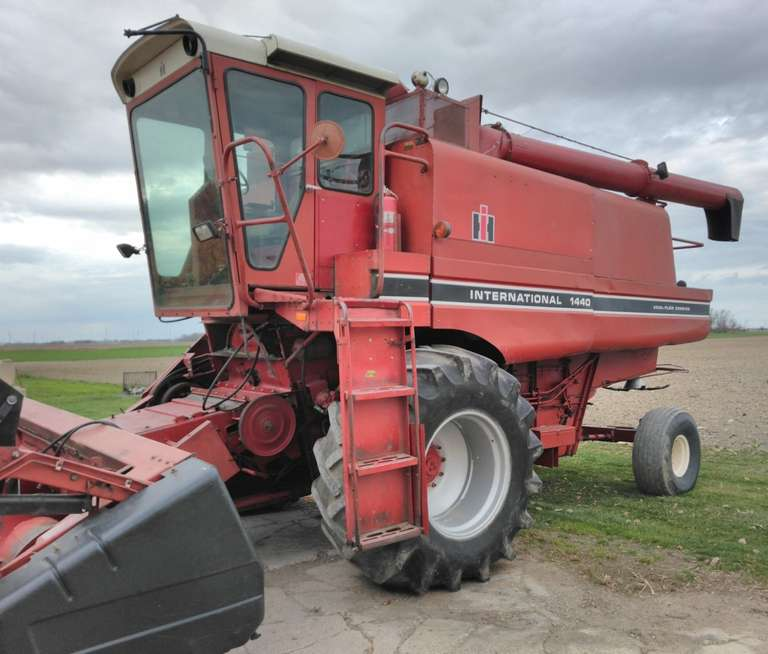 International 1440 Axial-Flow Combine with Straw Chopper and Rock Trap, Maintained by the Same Family Since 2002, Only 100 Acres on Kile Rotor Flights with Narrow Edged Wear Plates Installed in 2020, (One New Rear Tire, New Batteries, New Alternator, and Rebuilt Starter all in 2020), Tank Unloading Auger Sump Replaced in 2018, Transition Cone, Cage, Top Chafer, Clean Grain and Return Grain Chains Replaced within the Last Ten Years, Vertical and Horizontal Augers and Grain Tank Augers have bee...